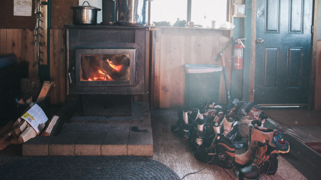Interior of a ski cabin with a roaring fireplace